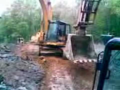Cat Caterpillar 330 excavator stuck in lake