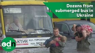 Firefighters save dozens from submerged bus in Ukraine