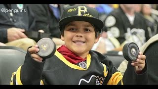 Little Penguins Fan Rewarded After Adult Steals Puck