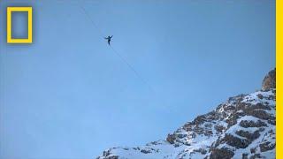 Champion Slackliners Cross Between Frozen Waterfalls in the Alps   National Geographic