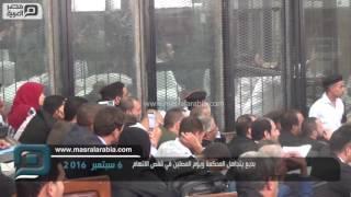 مصر العربية |  بديع يتجاهل المحكمة ويؤوم المصلين في قفص الاتهام