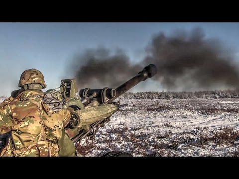 Army Soldiers Fire M119 Howitzer