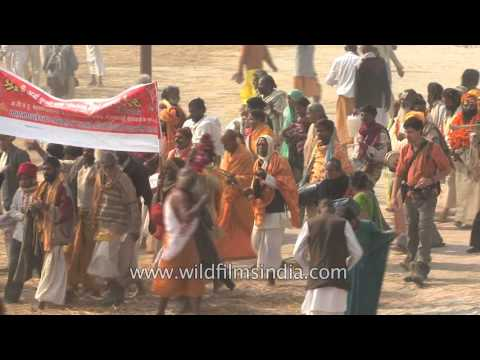 Thousands congregate to perform ritualistic bathing at Kumbh Mela