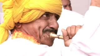 Drummers beating drum in parade ground, Mahavir Jayanti