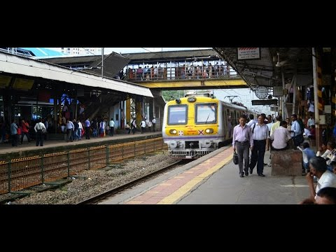 Churchgate fast local train crossing Goregaon Station