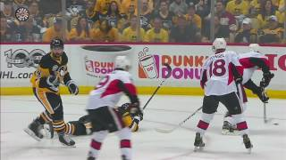Rust leaves Game 2 after getting crushed by Phaneuf