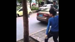 Kung fu kid shows off his poker card throwing power