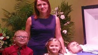 Woman Poses In Front Of Her Dead Husband With Her Kids