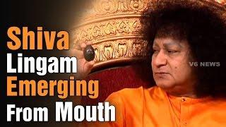 Bala Sai Baba miracles - Produces Shiva Lingam from mouth - Teenmaar News (18-02-2015)