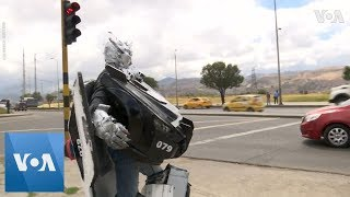 Colombian Transformer Makes a Living at Traffic Stop