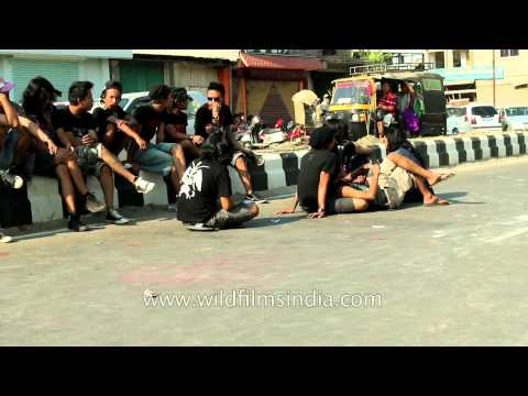 Youngsters of Manipur sit and relax on the streets of Imphal