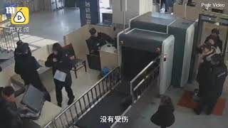 Moment five-year-old girl climbs into baggage X-ray machine