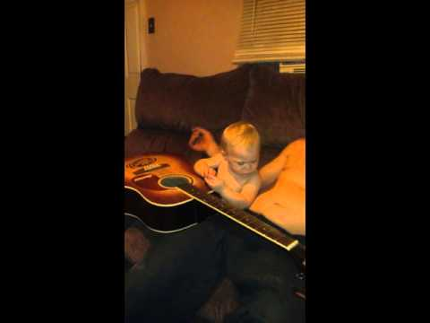 Cynphony playing daddys guitar