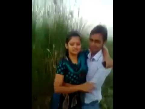 Sexy indian girl kissing in a field