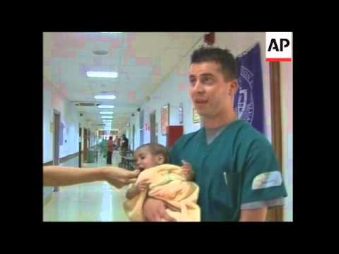 US troops care for Iraqi baby rescued from garbage
