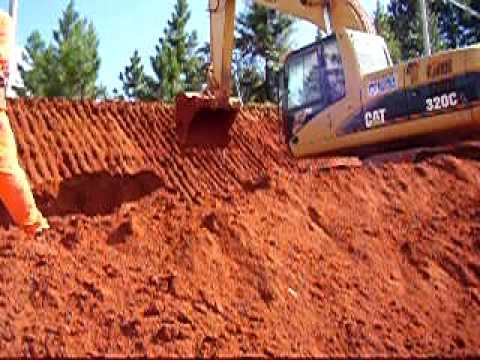 Escavadeira Rampando Celso Bueno Instrutor