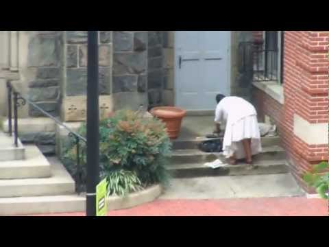 Crazy woman pees on old stone church