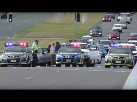 Police stop traffic and clear people from the bridge for RAAF training exercise in Canberra