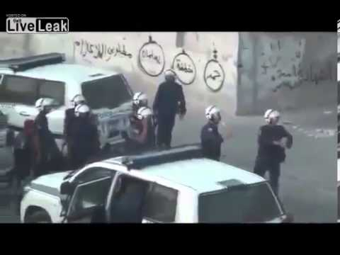 Xxx Mp4 18 Bahrain War Muslim Hijab Woman Confronts Police While They Shoot At Her 3gp Sex