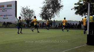 Hockey players in action at Kila Raipur Rural Olympic