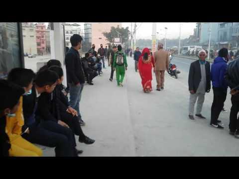 a funny school boy  entertaining public  teasing college girls at  TINKUNE,KTM,NEPAL