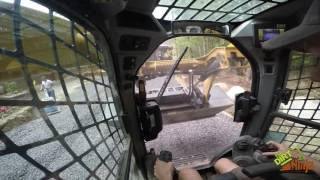 Cat 289D Spreading Stone For Driveway