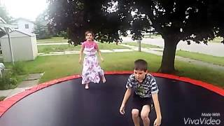 On Trampoline with brother and sister
