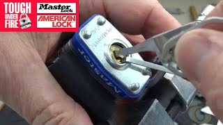 (672) Master Lock: Opened w/Cat Food Can Lid