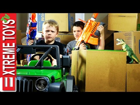 Nerf Gun Cardboard Box Battle Cole Attacks Ethan with Nerf Guns for Stealing His Dinosaur Toy