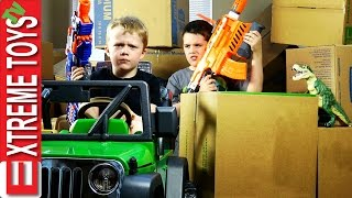 Nerf Gun Cardboard Box Battle! Cole Attacks Ethan with Nerf Guns for Stealing His Dinosaur Toy!