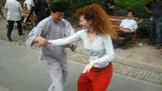 Girl doing Tai Chi Push Hands