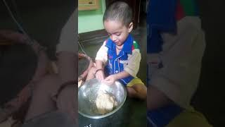 Cute Indian Baby Helping His Mother to Cooking