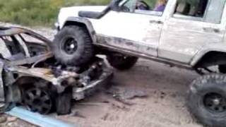 Female crushing a car in a cherokee