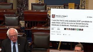 Bernie Sanders brings giant poster of Trump tweet to Senate floor