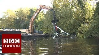 Derelict boats being lifted from the River Thames - BBC London