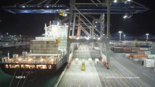 Container ship being unloaded at port.