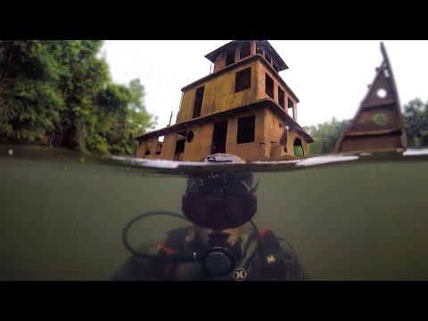 Scuba Diving Half Sunken Tug Boat in River Explored for Potential Treasure DALLMYD