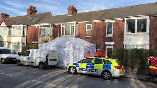 Police outside a property where an elderly man was found dead