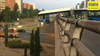 Watch: bus left hanging over Madrid bridge after accident