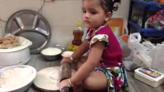 small Girl making roti