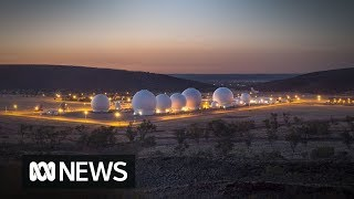 What does the US Pine Gap spy base do?
