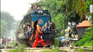 Careless Rail Road Crossing in front of Silk city Express Train of Bangladesh Railway.