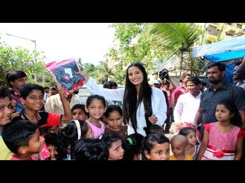 Xxx Mp4 Poonam Pandey Distributes Raincoats To Needy Kids 3gp Sex