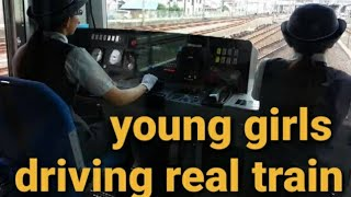 Japanese young girls driving a train in tokyo 2013