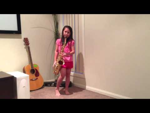 8 year old girl playing London Bridge on the Alto Saxophone