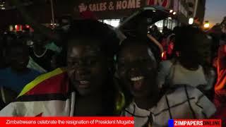 Zimbabweans celebrate the resignation of President Mugabe