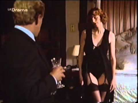 Gwyneth Strong strips down to stockings and suspenders