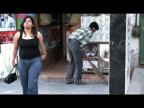Man sweeps shop at Green Park market as Delhi girl walks past, Delhi
