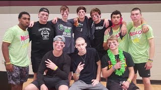 Teammates cheer on fellow high school football player who beat cancer