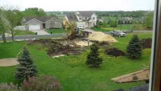 1st Day New Residential Construction Excavation Time Lapse - Northfield MN  May 2013